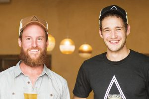 Two men from Angry Orchard Cindery smiling