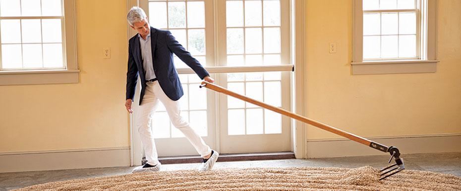 man raking malt