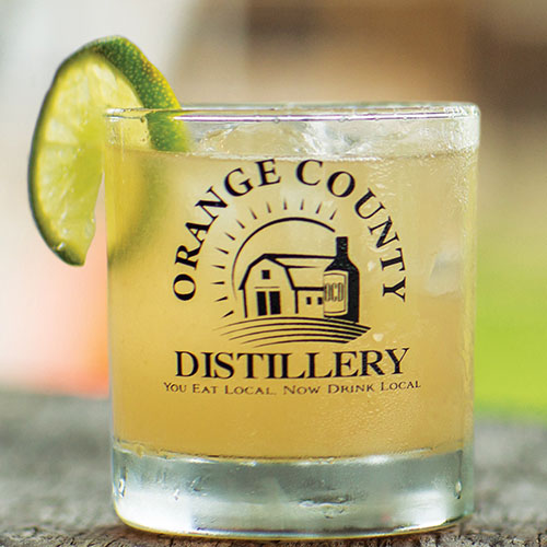 Cocktail with Orange County Distillery logo on glass