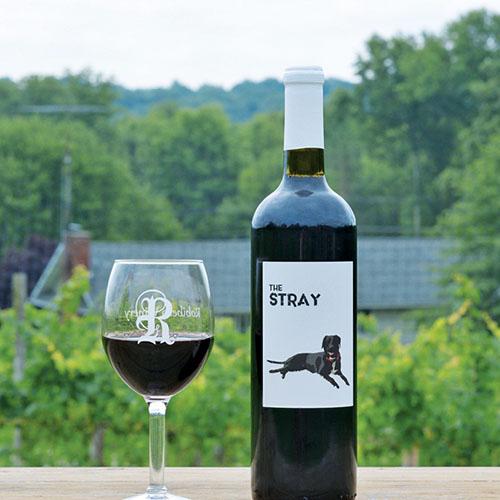 Robibero WInery's The Stray wine bottle next to a Robibero glass