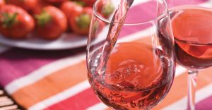 Glass of Rosé being poured