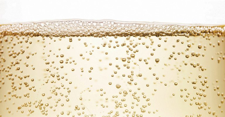 Sparkling wine bubbles close up