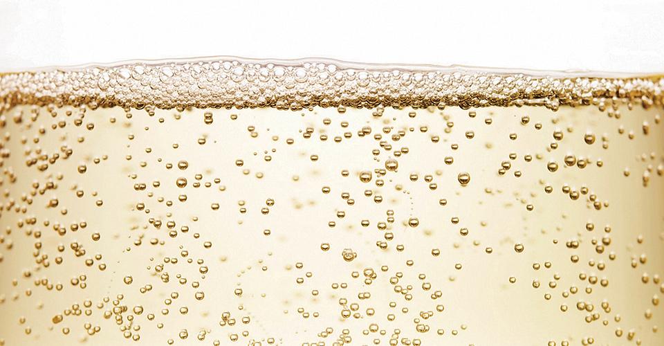 Sparkling wine bubbles close up