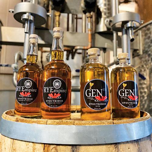 four bottles of Stoutrdige whiskies on wood barrel