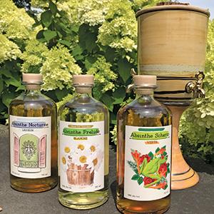 bottles of absinthe liquor with dispenser