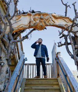 Ryan Burke standing on outdoor steps, at Angry Orchard.