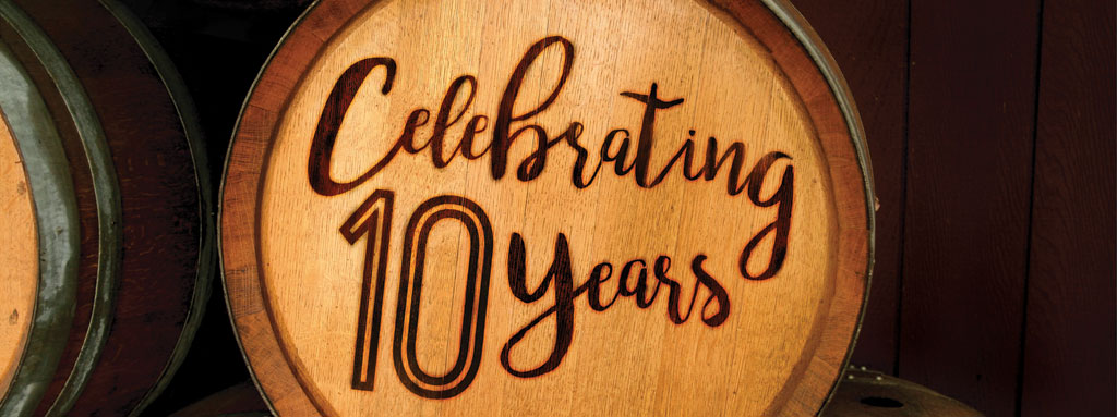 Cropped view of a wine barrel, with embossed text: