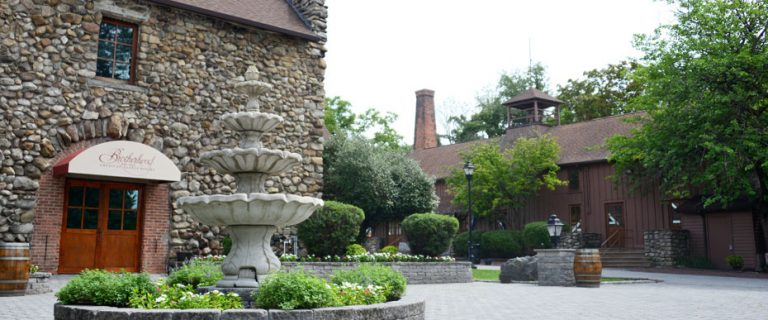View of Brotherhood Winery grounds with fountain in foreground.