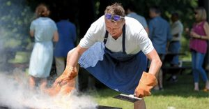 Chef Marc Murphy cooking on outdoor grill with smoke
