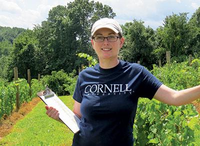 woman holding clipboard in vineyard