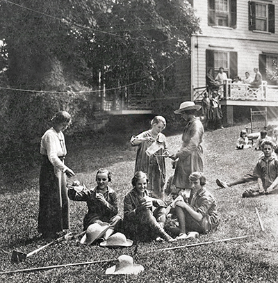 vintage black and white photo of women seated on grass