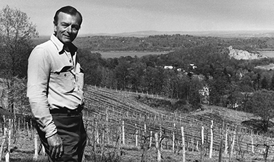black and white vintage image of Mark Miller overlooking vinyard