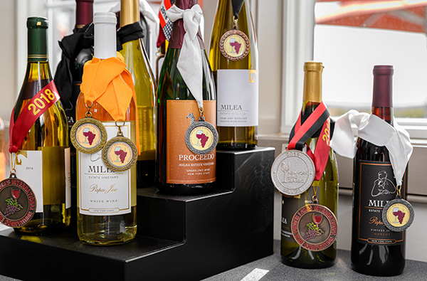 Bottles of wines with award ribbons on shelf
