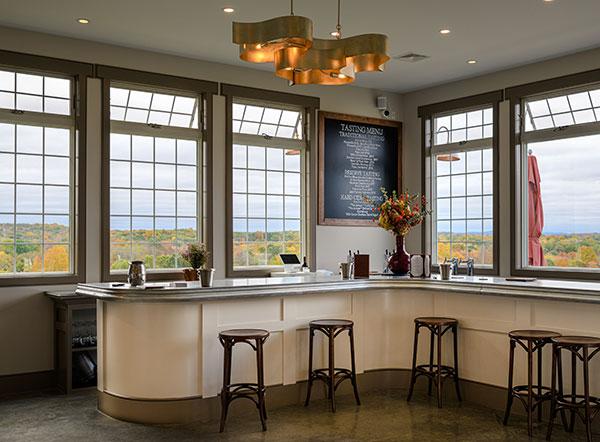 Milea tasting room interior showing windows, bar and stools