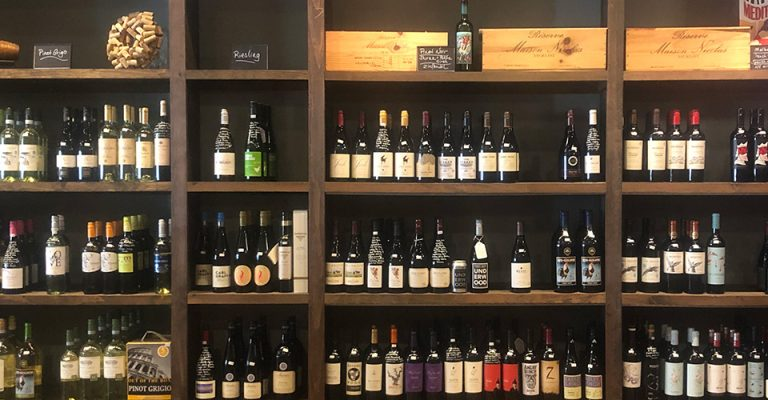 wall of wine bottles at a wiine shop