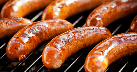 close-up of sausages on grill rack