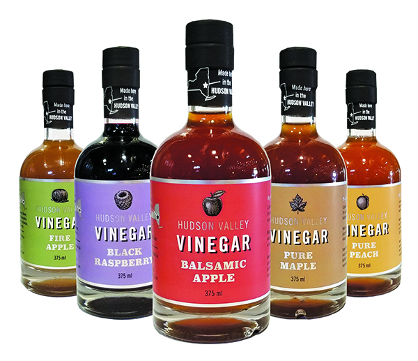 five bottles of vinegar in a v-shape formation