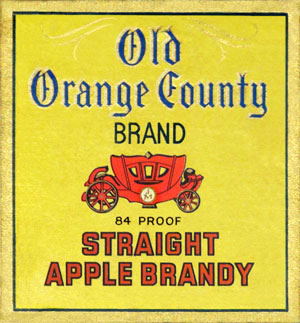 vintage label from Old Orange County Straight Apple Brandy with yellow background and red carriage