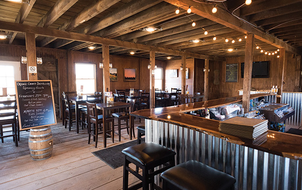 tasting room with wood paneling and steel bar