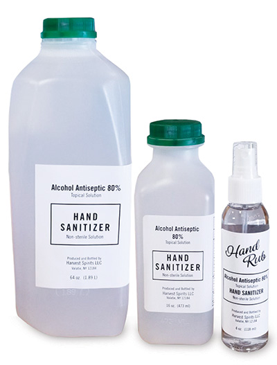 three sizes if hand sanizer in white plastic bottles