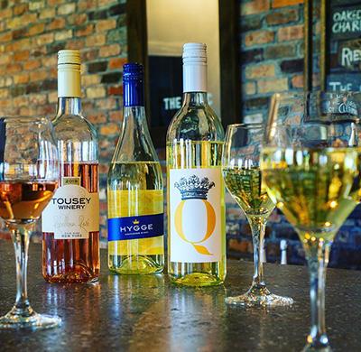 bottles of light wines on a tasting bar