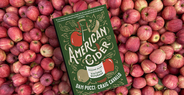 book cover on background of red apples