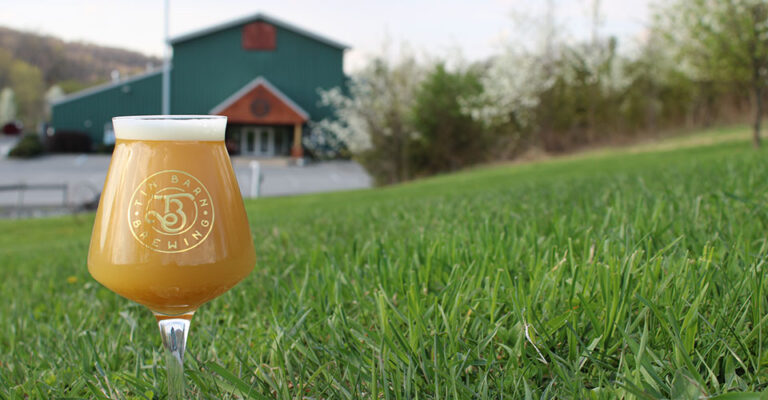 closeup of beer on lawn with soft focus building in background