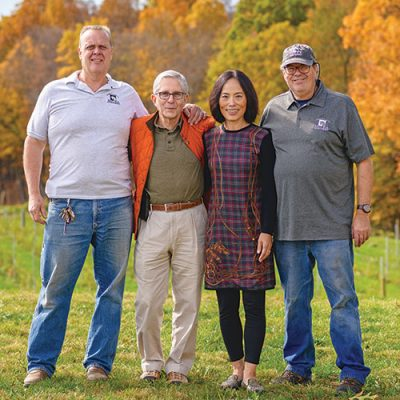 Milea owners ouside in fall