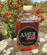 bottle of Stoutridge Amer liquor on a rock